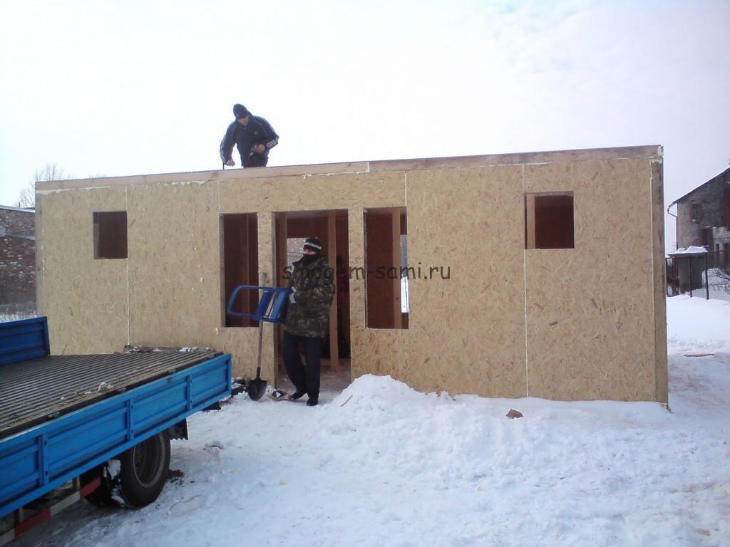 сборка дома с гаражом из структурных домостроительных панелей