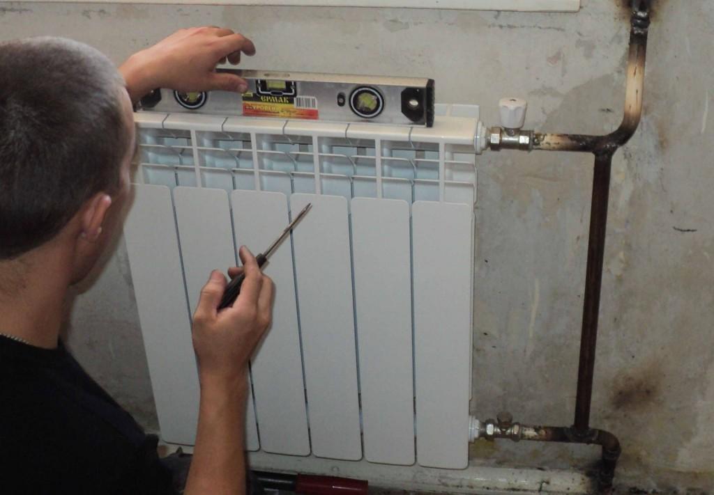 Установка батарей отопления фото